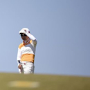 Ayako Uehara of Japan watches on the 9th hole during the women's British Open golf tournament at Royal Birkdale Golf Club in Southport, northern England, July 11, 2014. REUTERS/Nigel Roddis
