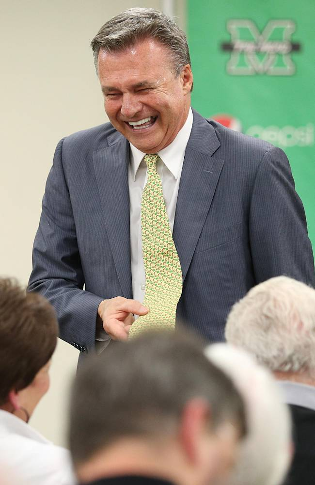 New Marshall University head basketball coach Dan D'Antoni laughs during an introductory news conference Friday, April 25, 2014, at the Marshall University Memorial Student Center in Huntington, W.Va