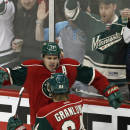 Minnesota Wild's Mikael Granlund, front, of Finland, congratulates Zach Parise on Parise's goal off Calgary Flames goalie Karri Ramo, of Finland, in the third period of an NHL hockey game, Friday, March 27, 2015, in St. Paul, Minn. The Wild won 4-2. (AP Photo/Jim Mone)