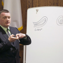 State Police fingerprint expert David Mackin illustrates fingerprint features during the murder trial of former New England Patriots football player Aaron Hernandez at Bristol County Superior Court Tuesday, March 3, 2015, in Fall River, Mass. Hernandez is accused of the June 2013 killing of Odin Lloyd. (AP Photo/Dominick Reuter)