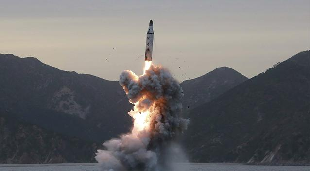 North Korea displays new long range, submarine based missiles on anniversary