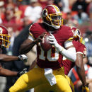 ADVANCE FOR WEEKEND EDITIONS, OCT. 18-19 - FILE - In this Sept. 14, 2014 file photo, Washington Redskins quarterback Robert Griffin III (10) looks to pass during the first half of an NFL football game against the Jacksonville Jaguars in Landover, Md. (AP Photo/Alex Brandon, File)