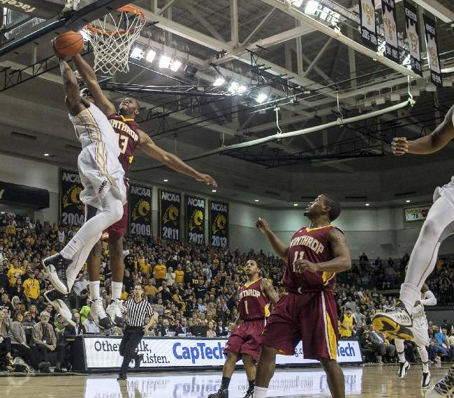 Winthrop forward Larry Brown, upper right, blocks a shot by VCU forward Juvonte Reddic, upper left, during the second half of an NCAA college basketball game in Richmond, Va., Saturday, Nov. 16, 2013. VCU won 92-71