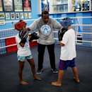 Teacher Alan (C) trains children on a boxing ring during an exercise session at a boxing school, in the Mare favela of Rio de Janeiro, Brazil, June 2, 2016. REUTERS/Nacho Doce