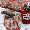 Wisconsin's Melvin Gordon (25) breaks away from Bowling Green's Jude Adjei-Barimah for a 50-yard touchdown run during the first half of an NCAA college football game, Saturday, Sept. 20, 2014, in Madison, Wis. (AP Photo/Morry Gash)