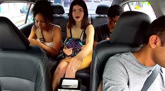 Shocking moment woman steals money from Uber driver's tip jar
