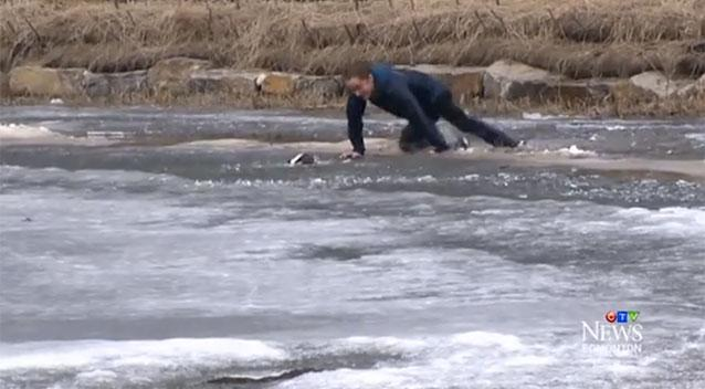 Video shows man jumping into freezing pond to save his dog