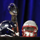 Jan 30, 2015; Phoenix, AZ, USA; General view of the Vince Lombardi Trophy and helmets for the Seattle Seahawks and New England Patriots during a press conference for Super Bowl XLIX at the Phoenix Convention Center. (Matthew Emmons-USA TODAY Sports)