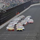 Sprint Cup Series drivers Carl Edwards (19) and Joey Logano (22) lead the field on the start of the NASCAR Brickyard 400 auto race at Indianapolis Motor Speedway in Indianapolis, Sunday, July 26, 2015. (AP Photo/Darron Cummings)
