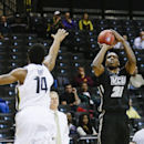 Virginia Commonwealth's Treveon Graham (21) shoots over Oregon's Ahmaad Rorie (14) during the first half of an NCAA college basketball game Tuesday, Nov. 25, 2014, in New York. (AP Photo/Frank Franklin II)