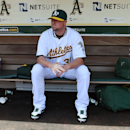 OAKLAND, CA - AUGUST 02: Starting pitcher Jon Lester #31 of the Oakland Athletics sits and looks on from the dugout prior to warming up for his start against the Kansas City Royals at O.co Coliseum on August 2, 2014 in Oakland, California. (Photo by Thearon W. Henderson/Getty Images)