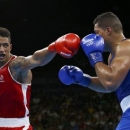 2016 Rio Olympics - Boxing - Final - Men's Super Heavy (+91kg) Final Bout 273 - Riocentro - Pavilion 6 - Rio de Janeiro, Brazil - 21/08/2016. Tony Yoka (FRA) of France and Joseph Joyce (GBR) of Britain compete.   REUTERS/Peter Cziborra