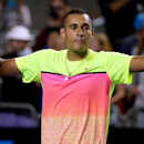 Nick Kyrgios of Australia celebrates after defeating Andreas Seppi of Italy in their fourth round match at the Australian Open tennis championship in Melbourne, Australia, Sunday, Jan. 25, 2015. (AP Photo/Rob Griffith)
