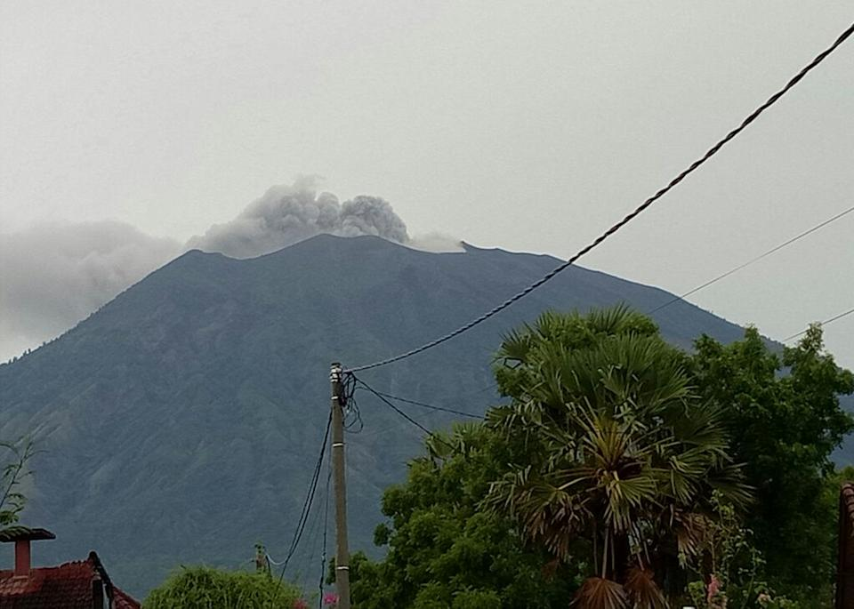A black ash cloud rises from the top of the volcano. Source 7 News