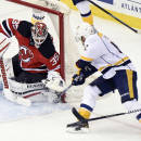 New Jersey Devils goaltender Cory Schneider makes a save on a shot by Nashville Predators Mike Fisher during the second period of an NHL hockey game Tuesday, March 3, 2015, in Newark, N.J. (AP Photo/Bill Kostroun)