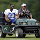 Indianapolis Colts running back Vick Ballard rides off the field on a cart after he was injured during the NFL team's football training camp in Anderson, Ind., Friday, July 25, 2014. (AP Photo/Michael Conroy)