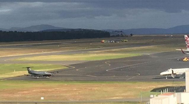 One dead, one injured in helicopter crash at Hobart airport, flights cancelled