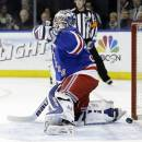 New York Rangers goalie Henrik Lundqvist, of Sweden, reacts after a puck shot by Philadelphia Flyers' Andrew MacDonald got past him for a goal during the first period in Game 1 of an NHL hockey first-round playoff series on Thursday, April 17, 2014, in New York. (AP Photo/Frank Franklin II)