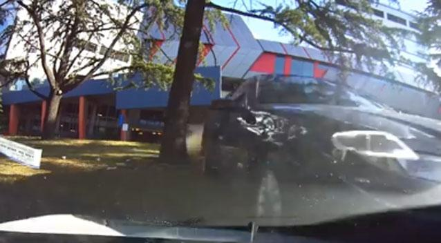 Footage shows out-of-control vehicle soaring over parked auto outside hospital
