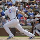 Chicago Cubs' Kris Bryant, left, hits a single during the first inning of a baseball game against the Miami Marlins, Sunday, July 5, 2015, in Chicago. (AP Photo/Nam Y. Huh)