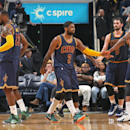 MEMPHIS, TN - MARCH 25: Kyrie Irving #2 and Tristan Thompson #13 of the Cleveland Cavaliers shake hands during the game against the Memphis Grizzlies on March 25, 2015 at FedExForum in Memphis, Tennessee. (Photo by Joe Murphy/NBAE via Getty Images)