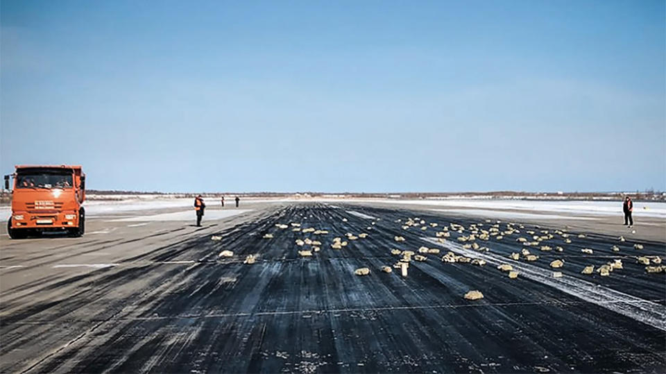 Gold rains down on Russian airport as plane takes off