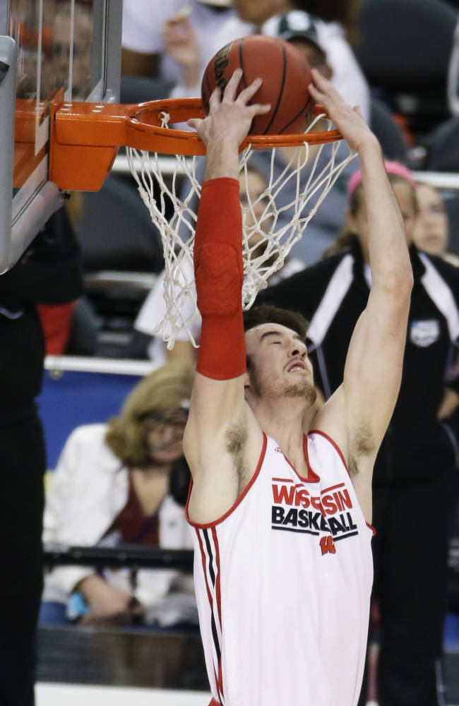 Wisconsin forward Frank Kaminsky dunks during practice for their NCAA Final Four tournament college basketball semifinal game Friday, April 4, 2014, in Dallas. Wisconsin plays Kentucky on Saturday, April 5, 2014