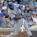 Kansas City Royals' Lorenzo Cain hits an one-run double against the Chicago Cubs during the eighth inning of an interleague baseball game Friday, May 29, 2015, in Chicago. (AP Photo/Nam Y. Huh)