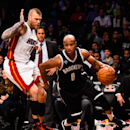 NEW YORK, NY - DECEMBER 16: Jarrett Jack #0 of the Brooklyn Nets dribbles around Chris Andersen #11 of the Miami Heat in the second half at the Barclays Center on December 16, 2014 in the Brooklyn Borough of New York City. (Photo by Alex Goodlett/Getty Images)