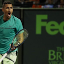 Mar 30, 2017; Miami, FL, USA; Nick Kyrgios of Australia reacts after winning a point against Alexander Zverev of Germany (not pictured) in a men's singles quarter-final during the 2017 Miami Open at Crandon Park Tennis Center. Kyrgios won 6-4, 6-7(9), 6-3. Geoff Burke-USA TODAY Sports