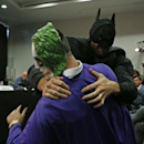 Boxing - Wladimir Klitschko & Tyson Fury Head-to-Head Press Conference - Hilton Syon Park, Brentford, Middlesex - 23/9/15 Tyson Fury, dressed as Batman tussles with someone dressed as The Joker during the press conference Action Images via Reuters / Andrew Couldridge Livepic