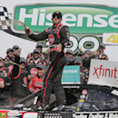 Austin Dillon celebrates in Victory Lane after winning the NASCAR Xfinity series auto race at Charlotte Motor Speedway in Concord, N.C., Saturday, May 23, 2015. (AP Photo/Chuck Burton)