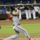 Washington Nationals' Bryce Harper (34) follows through on a three-run home run against the Miami Marlins in the fifth inning of a baseball game, Wednesday, July 29, 2015, in Miami. Yunel Escobar and Jayson Werth also scored on the home run. (AP Photo/Alan Diaz)