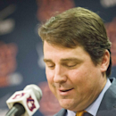 Former Florida head coach Will Muschamp speaks during a press conference at Auburn University, Saturday, Dec. 13, 2014, in Auburn, Ala. Auburn hired the former Florida coach as defensive coordinator Friday, hoping he can rebuild a defense that struggled badly late in the season. (AP Photo/Brynn Anderson)
