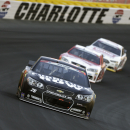 Martin Truex Jr. (78) leads cars out of Turn 4 during the NASCAR Sprint Cup series auto race at Charlotte Motor Speedway in Concord, N.C., Sunday, May 24, 2015. (AP Photo/Chuck Burton)