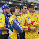 Marco Andretti, front left, and Ryan Hunter-Reay, front right, watch the wreck of James Hinchcliffe, of Canada, on a video screen during practice for the Indianapolis 500 auto race at Indianapolis Motor Speedway in Indianapolis, Monday, May 18, 2015. (AP Photo/Darron Cummings)