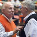 FILE - In this Jan. 18, 2014, file photo, former Illinois coach Lou Henson, left, chats with Rod Cardinal during Illinois' NCAA college basketball game in Champaign, Ill. Henson, the former New Mexico State and Illinois men's basketball coach, who is set to be inducted into the College Basketball Hall of Fame this fall, is at a Houston hospital awaiting tests due to a weaken immune system. On Sunday, June 21, 2015, Henson traveled to M.D. Anderson Cancer Center in Houston, where he has been treated throughout the years after his 2003 diagnosis of non-Hodgkins lymphoma. (AP Photo/Robin Scholz, File)
