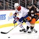 ANAHEIM, CA - MARCH 04:  Sergei Gonchar #55 of the Montreal Canadiens and Jiri Sekac #46 of the Anaheim Ducks skate after the puck during a 3-1 Ducks win at Honda Center on March 4, 2015 in Anaheim, California.  (Photo by Harry How/Getty Images)