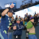 Dec 28, 2014; Seattle, WA, USA; Seattle Seahawks quarterback Russell Wilson (3) returns to the locker room following a 20-6 victory against the St. Louis Rams at CenturyLink Field. (Joe Nicholson-USA TODAY Sports)