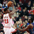 Oct 19, 2014; Chicago, IL, USA; Chicago Bulls guard Jimmy Butler (21) drives to the basket against Charlotte Hornets center Al Jefferson (25) during the first half at United Center. (Jerry Lai-USA TODAY Sports)