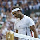 Rafael Nadal of Spain walks after losing the singles match against Dustin Brown of Germany, at the All England Lawn Tennis Championships in Wimbledon, London, Thursday July 2, 2015. (AP Photo/Pavel Golovkin)