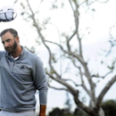 February 19, 2017; Pacific Palisades, CA, USA;  Dustin Johnson reacts after making his putt on the eighteenth hole green to win thethe Genesis Open golf tournament at Riviera Country Club. Mandatory Credit: Gary A. Vasquez-USA TODAY Sports