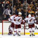 Arizona Coyotes' Brandon Gormley (33) and Antoine Vermette skate away after the Boston Bruins scored on goalie Mike Smith during the first period of an NHL hockey game in Boston Saturday, Feb. 28, 2015. (AP Photo/Winslow Townson)