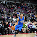 AUBURN HILLS, MI - DECEMBER 17: Devin Harris #20 of the Dallas Mavericks drives to the basket against the Detroit Pistons on December 17, 2014 at the Palace of Auburn Hills in Auburn Hills, Michigan. (Photo by Allen Einstein/NBAE via Getty Images)
