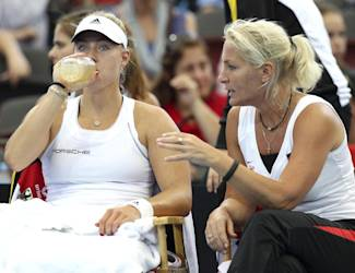 Angelique Kerber of Germany, left, and her team captain Barbara Rittner, right, talk between sets during the Fed Cup semi-finals between Australia and Germany in Brisbane, Australia, Saturday, April 19, 2014. (AP Photo/Tertius Pickard)