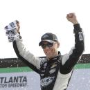 Driver Kevin Harvick celebrates after winning the NASCAR Xfinity series auto race at Atlanta Motor Speedway Saturday, Feb. 28, 2015, in Hampton, Ga. (AP Photo/John Amis)