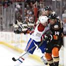 ANAHEIM, CA - MARCH 04:  Tomas Fleischmann #14 of the Anaheim Ducks is checked along the boards by Jeff Petry #26 of the Montreal Canadiens during a 3-1 Ducks win at Honda Center on March 4, 2015 in Anaheim, California.  (Photo by Harry How/Getty Images)