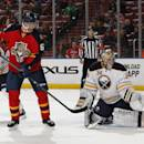 Florida Panthers forward Jaromir Jagr (68) looks back as Buffalo Sabres goaltender Michal Neuvirth (34) allows a goal by forward Brandon Pirri (71) (not pictured) during the second period of an NHL hockey game, Saturday, Feb. 28, 2015, in Sunrise, Fla. (AP Photo/Joel Auerbach)
