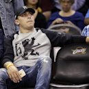 Cleveland Browns quarterback Johnny Manziel watches warmups before the second half of a preseason NBA basketball game between the Cleveland Cavaliers and the Dallas Mavericks on Friday, Oct. 17, 2014, in Cleveland. The Mavericks won 108-102. (AP Photo/Mark Duncan)