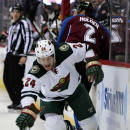 Minnesota Wild left wing Matt Cooke reaches to control the puck against the Colorado Avalanche in the first period of Game 2 of an NHL hockey first-round playoff series on Saturday, April 19, 2014, in Denver. (AP Photo/Jack Dempsey)